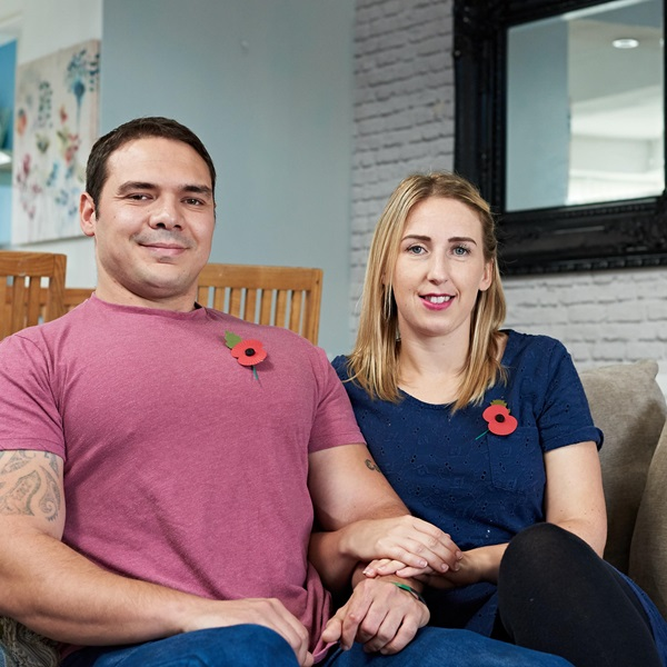 A couple who have received support from the Royal British Legion sitting on a sofa