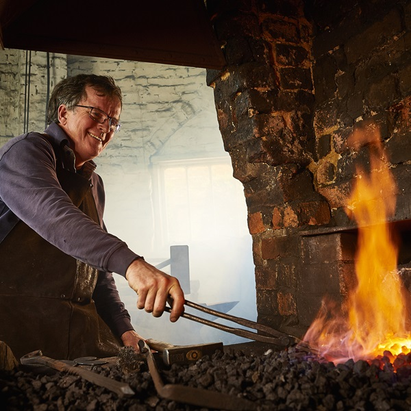 Veteran Tim Mackereth working as a blacksmith