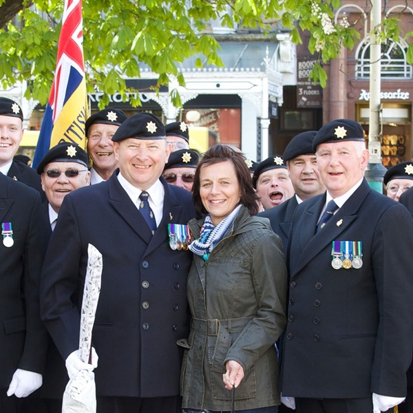 Members of local branch pose wearing medals