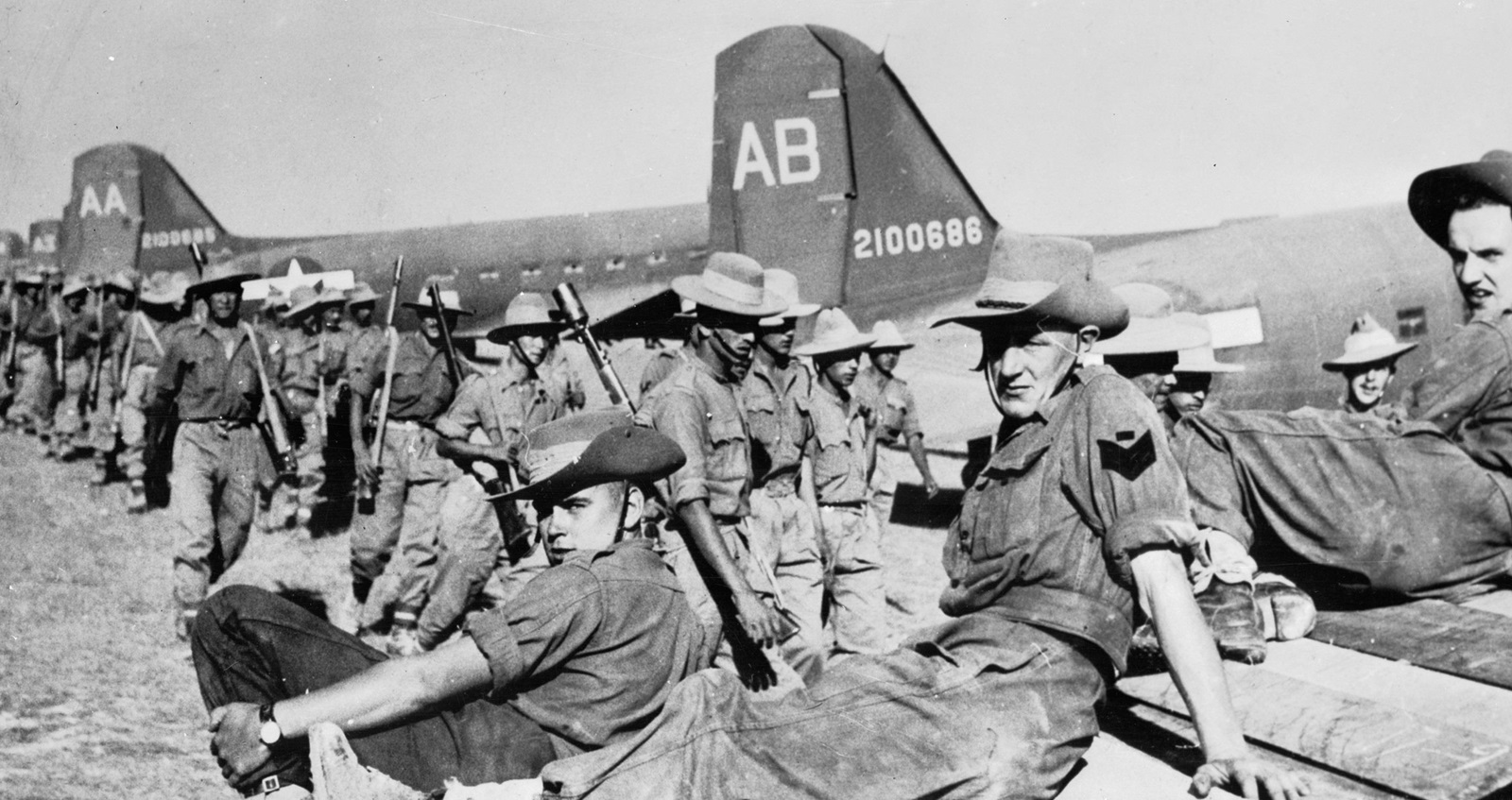 Chindits. British, West African and Gurkha soldiers waiting at an airfield in India before Operation 'Thursday' March 1944 (IWM 020832)