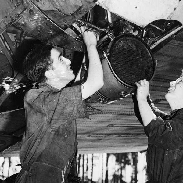 RAF and WRAF fitters working on the engine of an aircraft at Gatow.