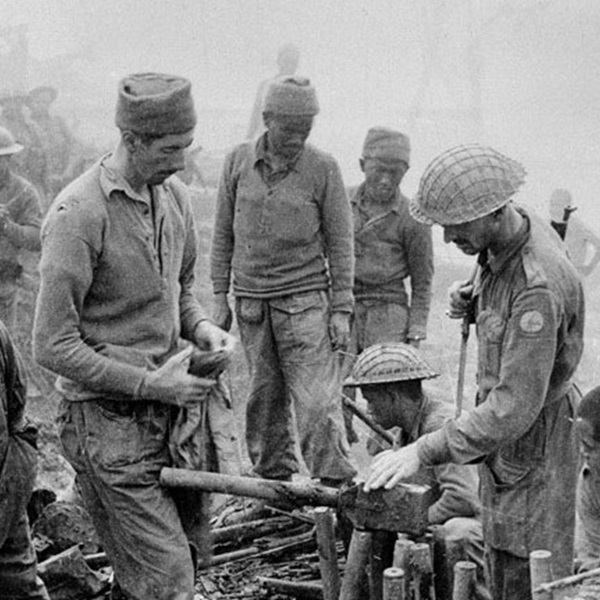 Indian and Gurkha soldiers inspect captured Japanese ordnance during the Imphal-Kohima battle, 1944