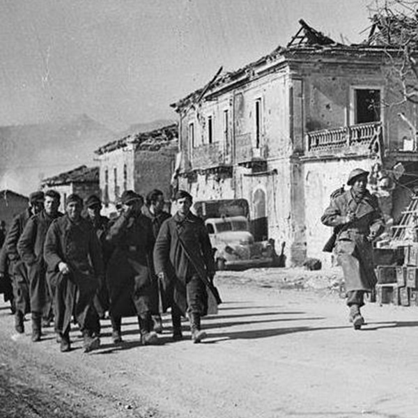 A German patrol captured by Maori troops of the New Zealand Division are marched to POW camps along the Via Casilina in Cassino.