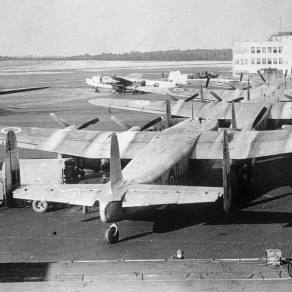A queue of Avro Yorks of Royal Air Force Transport Command at an airfield in West Germany, awaiting their turn to taxi to the end of the runway and take off on their journey to Berlin.