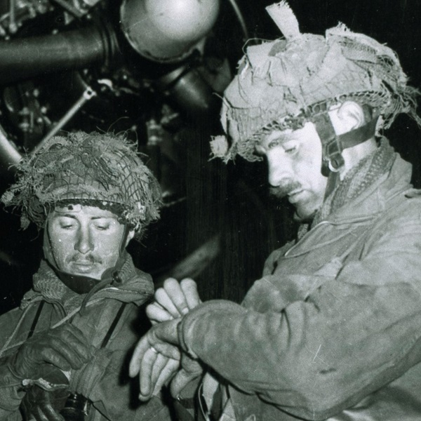 Two paratroopers preparing to drop into Normandy