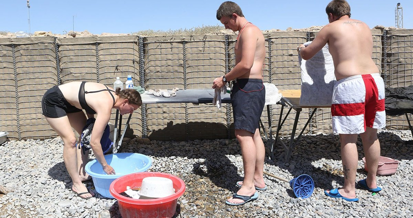 Anna Crossley in Afghanistan washing clothes with other soldiers