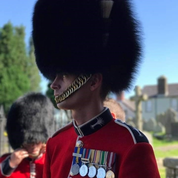 British Army soldier Adam, wearing a bearskin