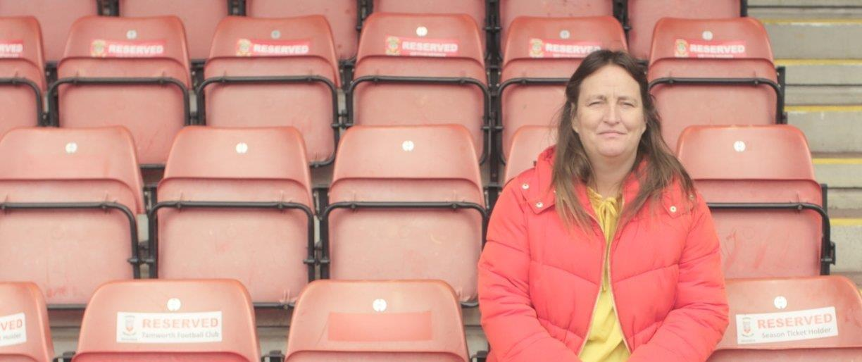 Chantelle sitting in the stand at her local football club