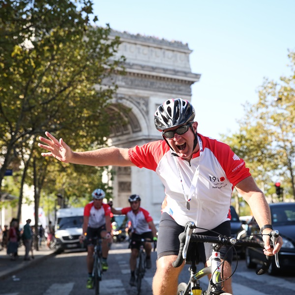 Pedal to Paris 2018 cyclist waving