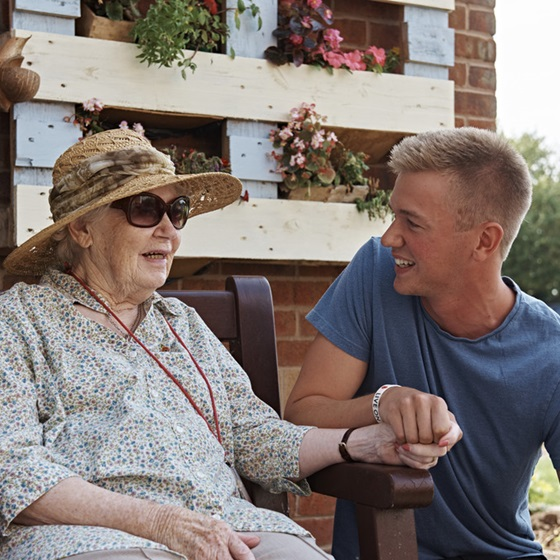 A young volunteer spending time with a care home resident