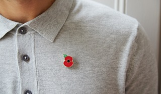 Man sporting iconic Poppy pin from the Poppy Shop