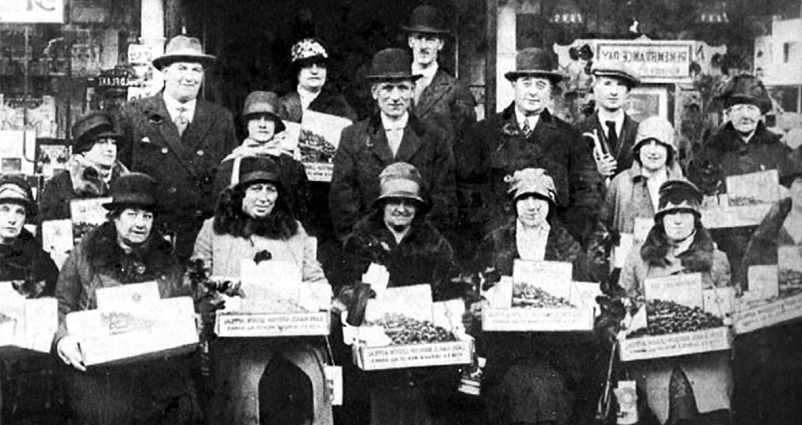 Black and white photograph of early poppy sellers